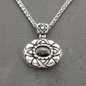 ROUND STERLING SILVER PENDANT WITH CARVED DESIGN & ONYX