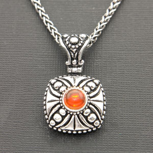 OXIDIZED STERLING SILVER PENDANT WITH CROSS DESIGN AND AMBER
