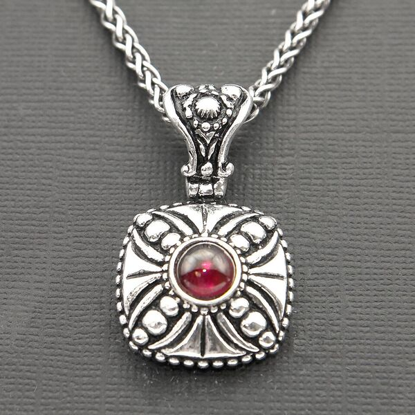 OXIDIZED STERLING SILVER PENDANT WITH CROSS DESIGN AND GARNET