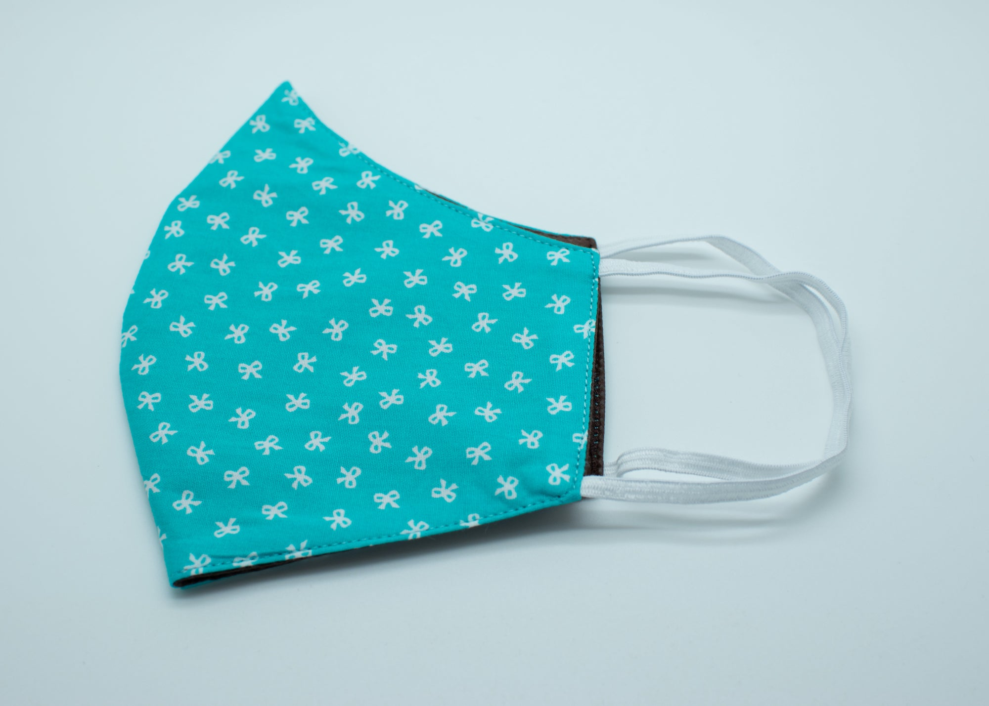 Turquoise with White Bows Mask