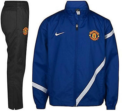 NIKE MANCHESTER UNITED  YOUTH SIDELINE WOVEN WARM UP TRACKSUIT BOYS.