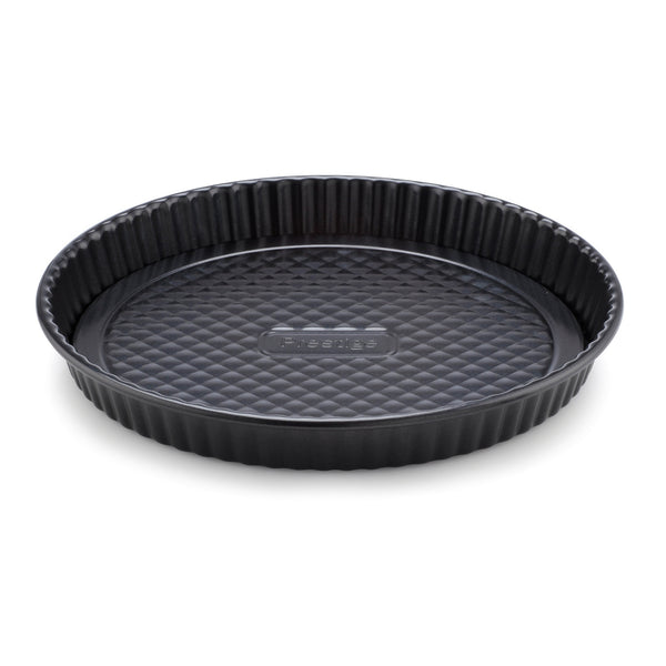 Prestige Inspire non stick quiche tin. Heavy carbon steel for extra durability. Cook delicious quiches and pies easily, without them getting stuck to the sides of the tin