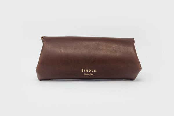 Long brown leather purse with gold embossed Bindle logo on grey background