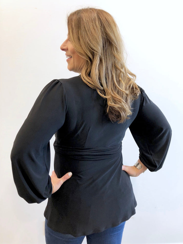 black matte jersey blouse with blouson sleeves and puffy shoulders. Tie waist. Made in Canada. Machine washable. Wrinkle free.