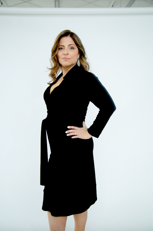 black wrap dress with 3/4 length sleeves. Made in Canada. Machine washable. Wrinkle free.