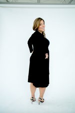 matte jersey wrap dress with 3/4 length sleeves. Made in Canada. Machine washable. Wrinkle free.