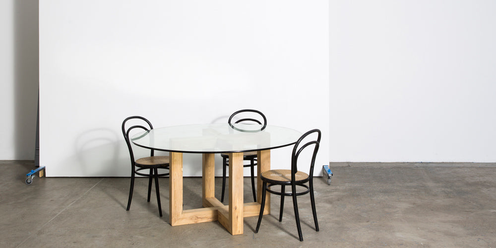 Global dining table with glass top by MCM House