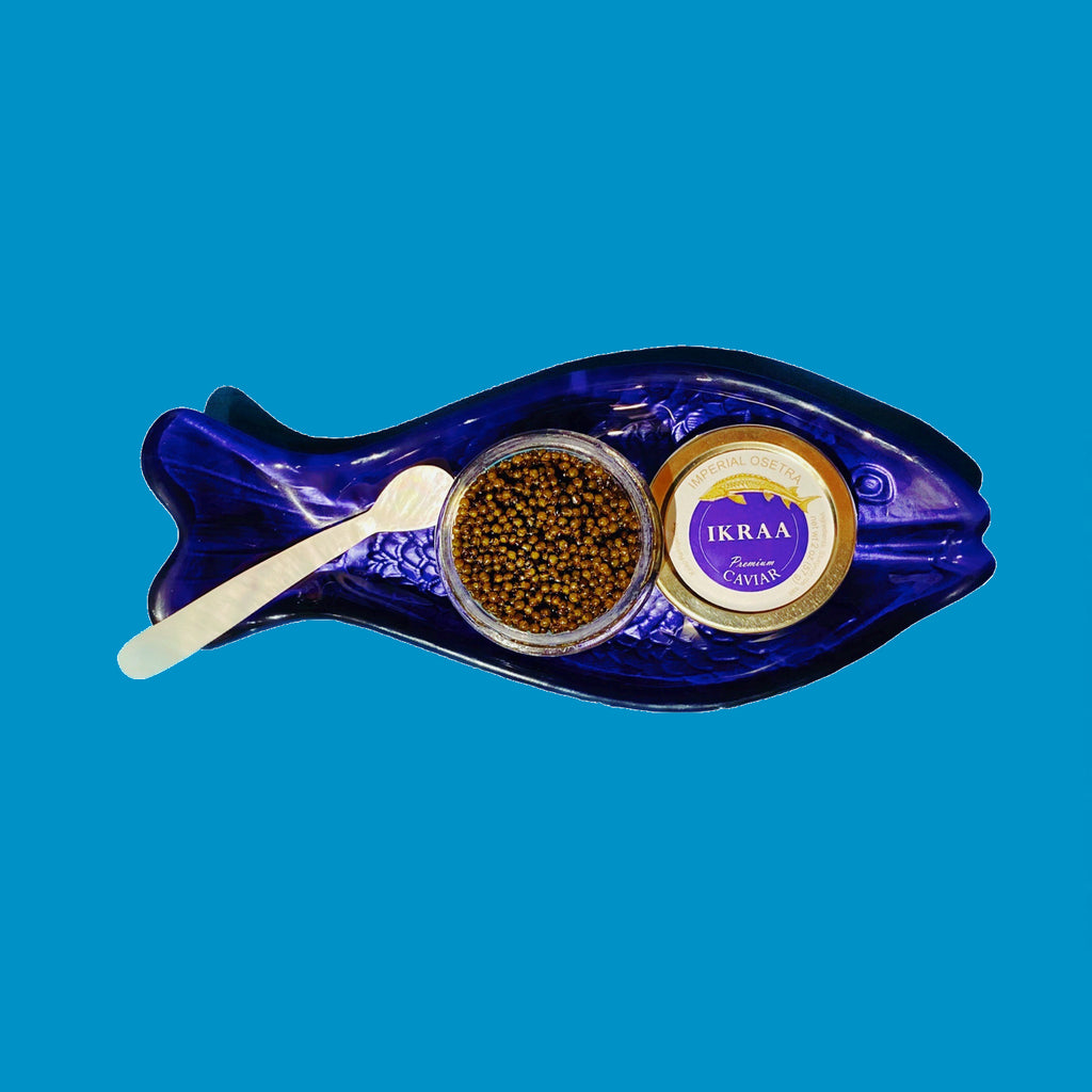 1 oz tin of imperial osetra on a fish shaped dish