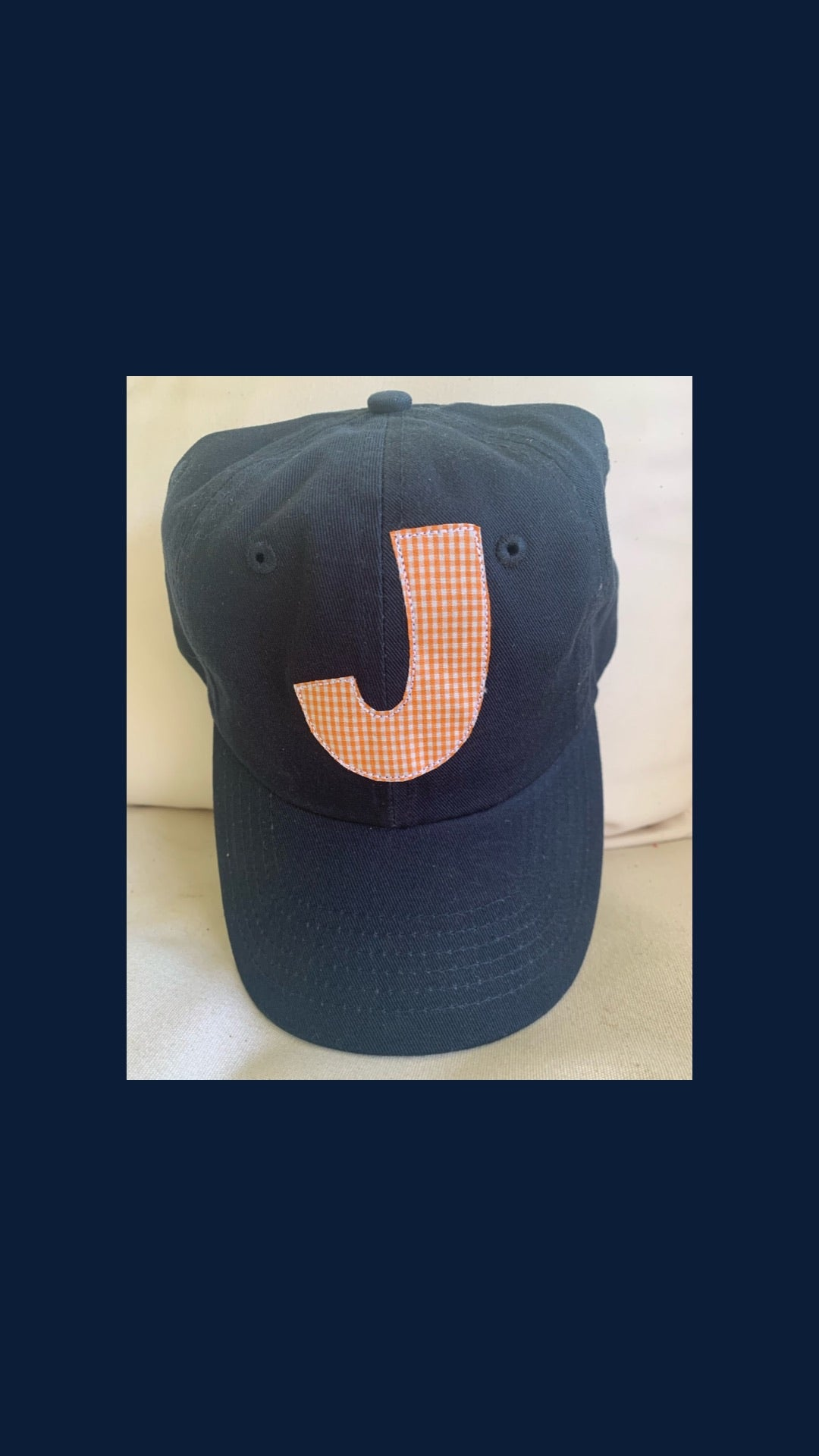 Navy and orange hat