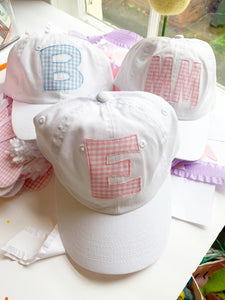 Initial White Hat in pink and blue