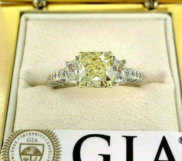 GIA 2.60 Carats t.w. Radiant Fancy Yellow VS1 Trapezoids Diamond Engagement Ring