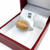 3.23 Carats t.w. Diamond and Opal Halo Ring Opal is 2.85 Carats 14K White Gold