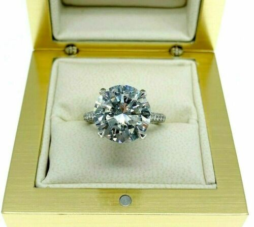 6.31 Carats t.w. F SI2 Round Cut Diamond Under Halo Engagement Ring 5.35 Center