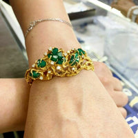 12.25 Carats t.w. Rough Emerald and Diamond Bangle Bracelet 14K Yellow Gold