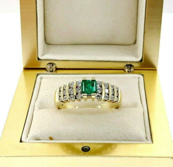 Fine 0.85 Carats t.w. Diamond and Colombian Emerald Channel Set Ring 18K Gold