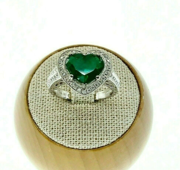 2.08 Carats t.w. Diamond and Emerald Halo Ring 18K Gold Emerald is 1.68 Carats
