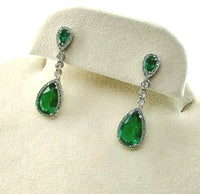 3.72 Carats t.w. Emerald and Diamond Dangle Earrings Emeralds are 3.32 Carats tw