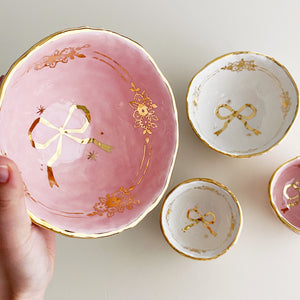 luxury handmade hand-built pottery with genuine gold. golden floral ribbon bowls