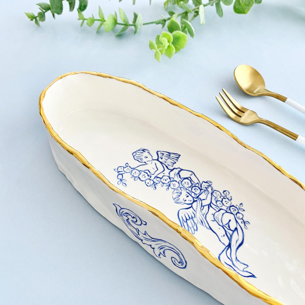 unique shaped handmade oval bowls with 24k gold rim and baby angels illustration