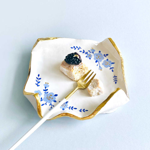 real gold elegant handmade ceramics with hand-painted blue flowers.