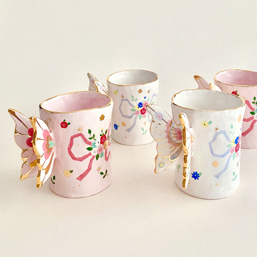 This butterfly wings mugs are very elegant, delicate and unique. handmade and hand-painted gold luster pottery and ceramics.