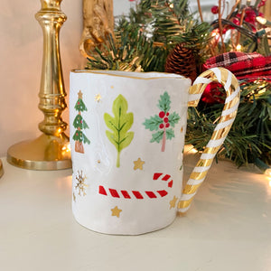 unique candy cane handle mug with real gold decoration. this is handmade and hand-painted pottery