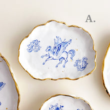Load image into Gallery viewer, unique and delicate cherubs angel drawing plates. they are organic shaped handmade pottery. they are decorated with genuine gold rims.