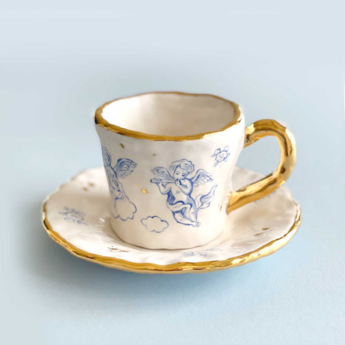 handmade 24k gold baby angels illustration cup and saucer.