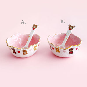 adorable pink bowls and spoon set with teddy bear illustration with gold luster.