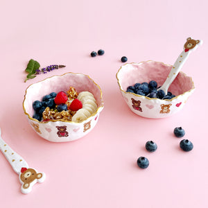 adorable pink bowls with teddy bear illustration with gold luster.