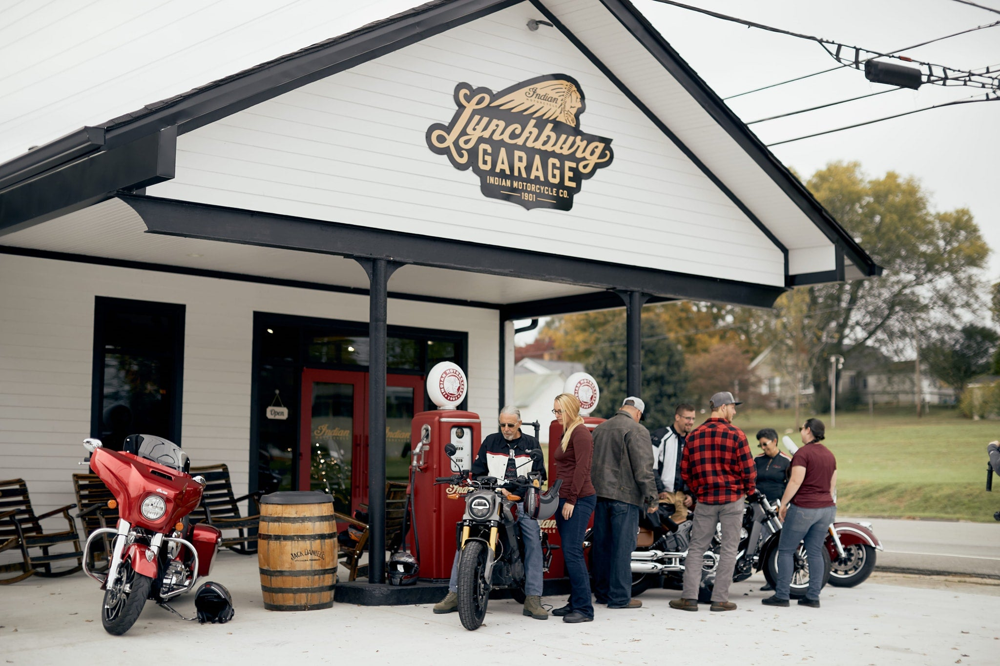 Lynchburg Garage exterior with customers gathered on motorcycles