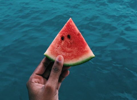 Hand holding a watermelon