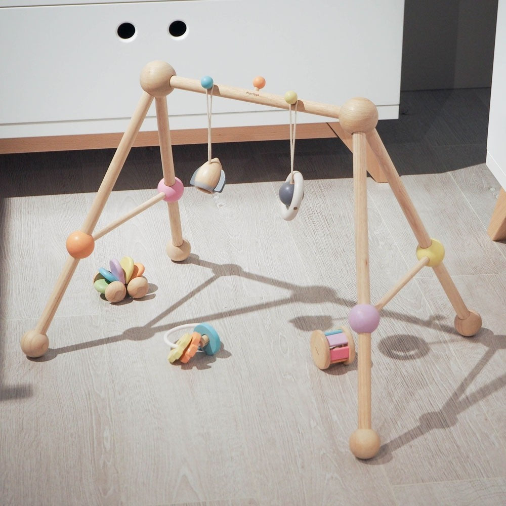 Wooden baby gym Plan Toys