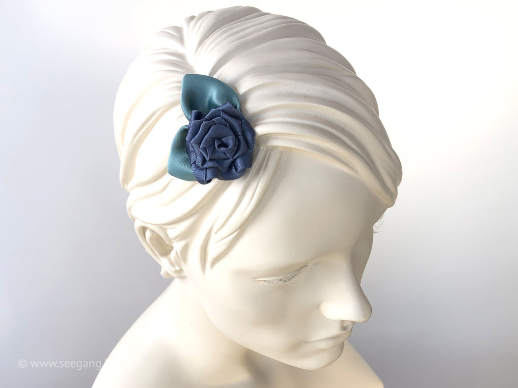 Something Blue: Hair Flower Fascinator with roses in dusty blue tones, leaves in sage green.
