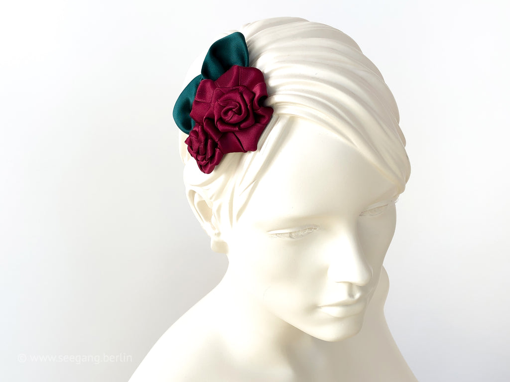Fascinator Hair flowers with deep red Roses with dark green leaves.