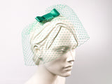 BIRDCAGE FASCINATOR -  HEADDRESS WITH A VEIL AND A BOW IN NEO MINT SILVE SAGE GREEN