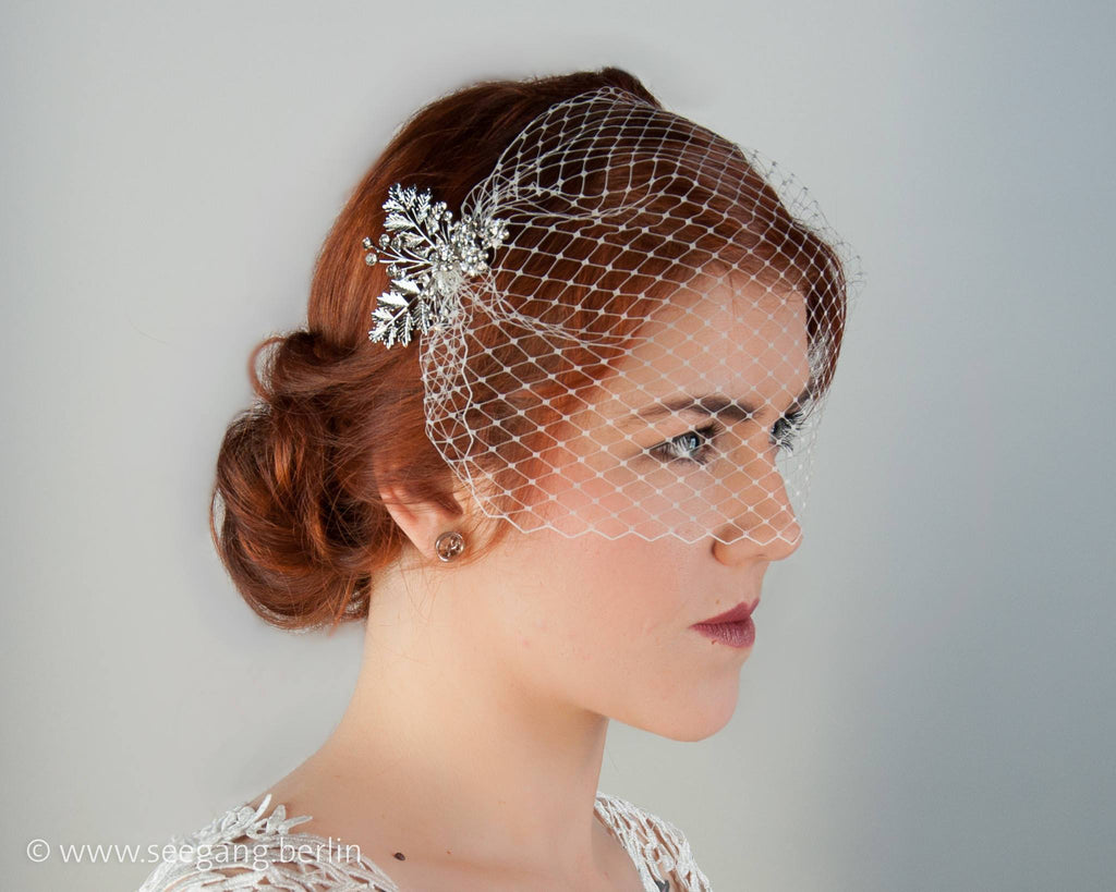 BIRDCAGE - BRIDAL VEIL HEADDRESS HOLD BY HAIR COMBS WITH RHINESTONES IN SILVER COLOUR © Seegang Berlin