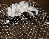BIRDCAGE - BRIDAL VEIL HEADDRESS WITH AIRY DRAPED LACE FLOWERS © Seegang Berlin
