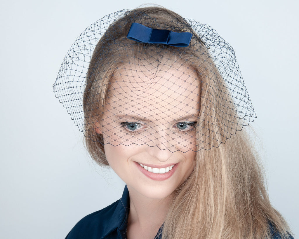BIRDCAGE - VEIL HEADDRESS WITH A BOW IN BLUE SHADES FROM LIGHT TO DARK BLUE, BLUESTONE TO GALAXY BLUE © Seegang Berlin