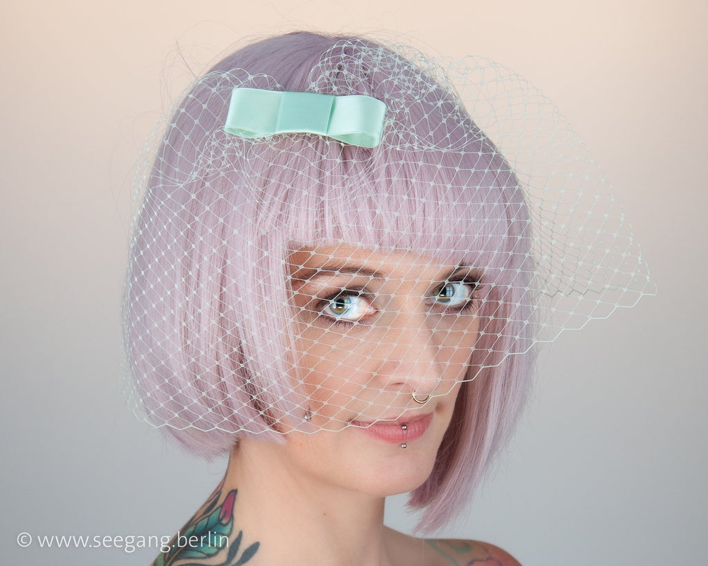 BIRDCAGE - VEIL HEADDRESS WITH A BOW IN LIGHT GREEN SHADES LIKE TEAL EUCALYPTUS, NEO MINT, SILVER SAGE GREEN © Seegang Berlin