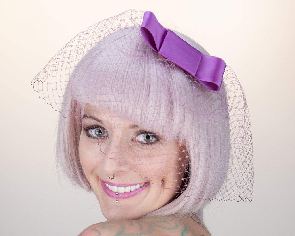 BIRDCAGE - VEIL HEADDRESS WITH A BOW IN SHADES OF LILAC LIKE HOT, SHOCKING, FUCHSIA AND MAGENTA © Seegang Berlin