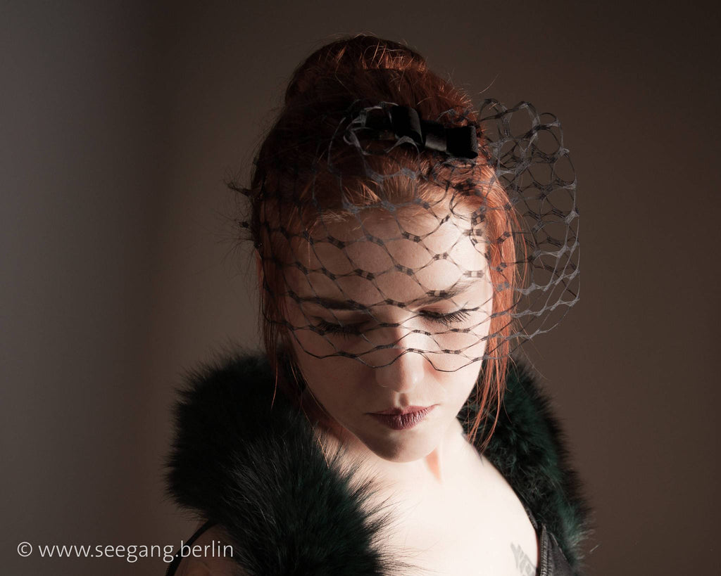 BIRDCAGE - VEIL HEADDRESS WITH A LEATHER BOW FOR DARK OCCASIONS © Seegang Berlin