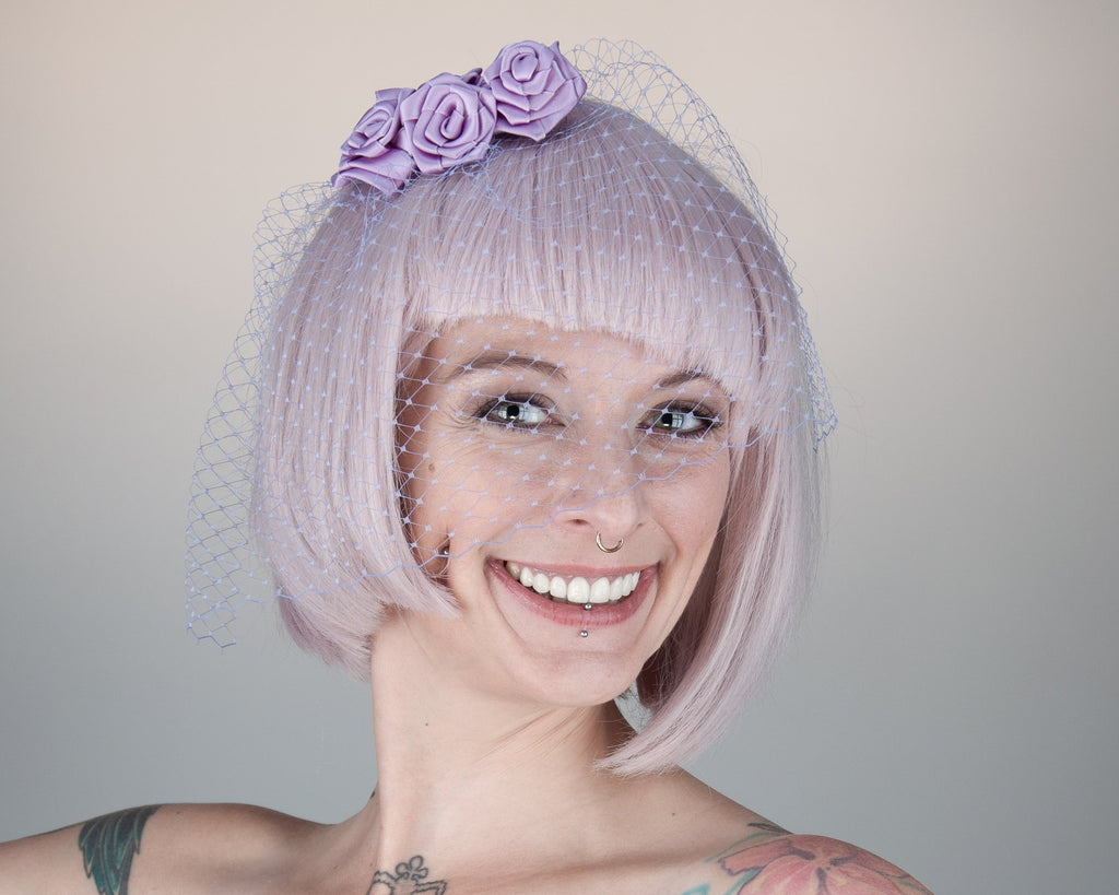 BIRDCAGE - VEIL HEADDRESS WITH ROSES IN SHADES OF PUPRLE FROM LIGHT LAVENDER TO LILAC AND MAUVE © Seegang Berlin