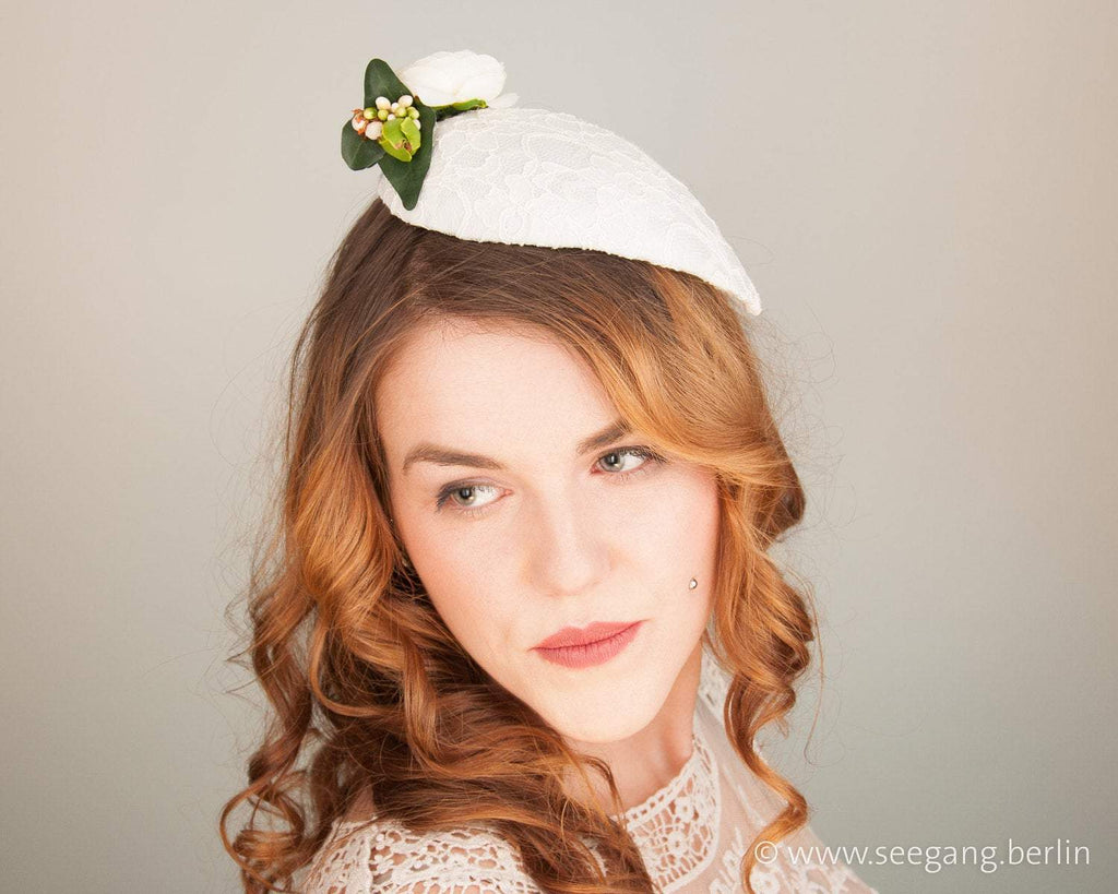 FASCINATOR - BRIDAL HEADPIECE IN DROP SHAPE WITH OFF WHITE LACE AND FLOWERS © Seegang Berlin