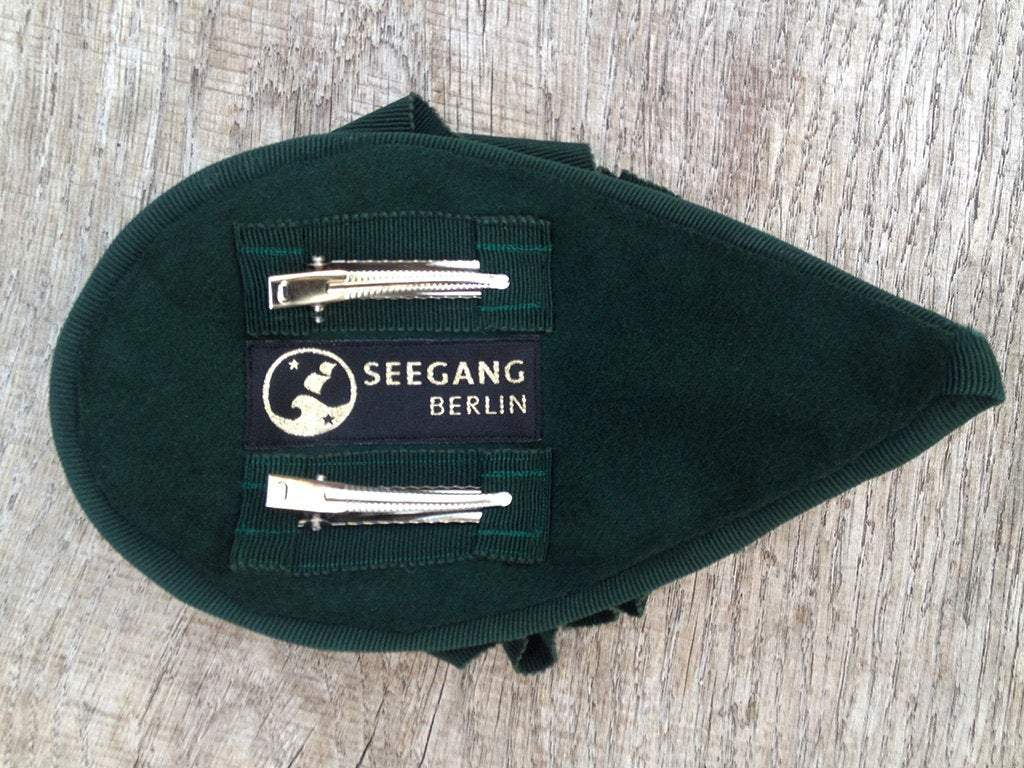 FASCINATOR - DROP SHAPE HEADDRESS WITH DRAPED WITH VELVET RIBBON IN DARK GREEN © Seegang Berlin