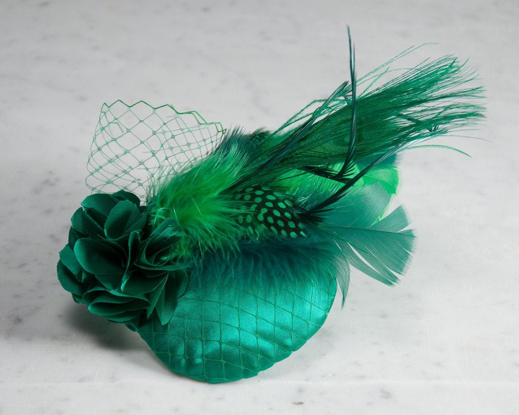 FASCINATOR - HEADDRESS WITH A PEACOCK FEATHER IN AN AQUA TURQUOISE CONTEXT © Seegang Berlin