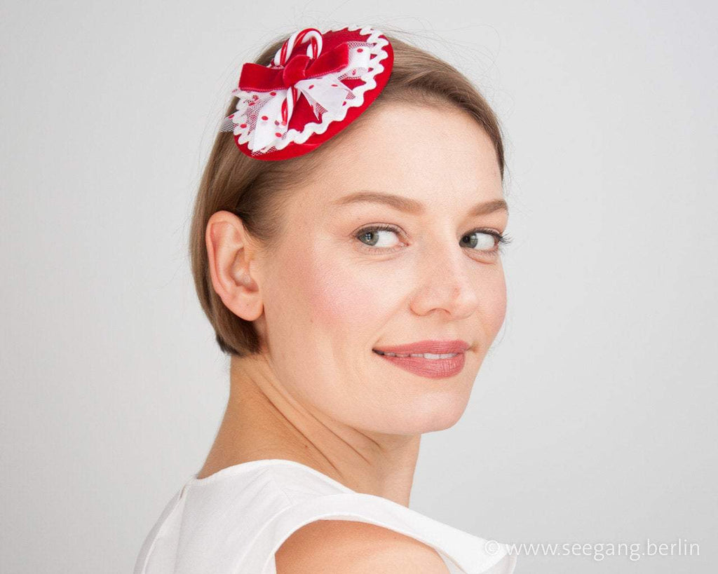 FASCINATOR - SWEET RED AND WHITE HAT WITH A SUGARCANE © Seegang Berlin
