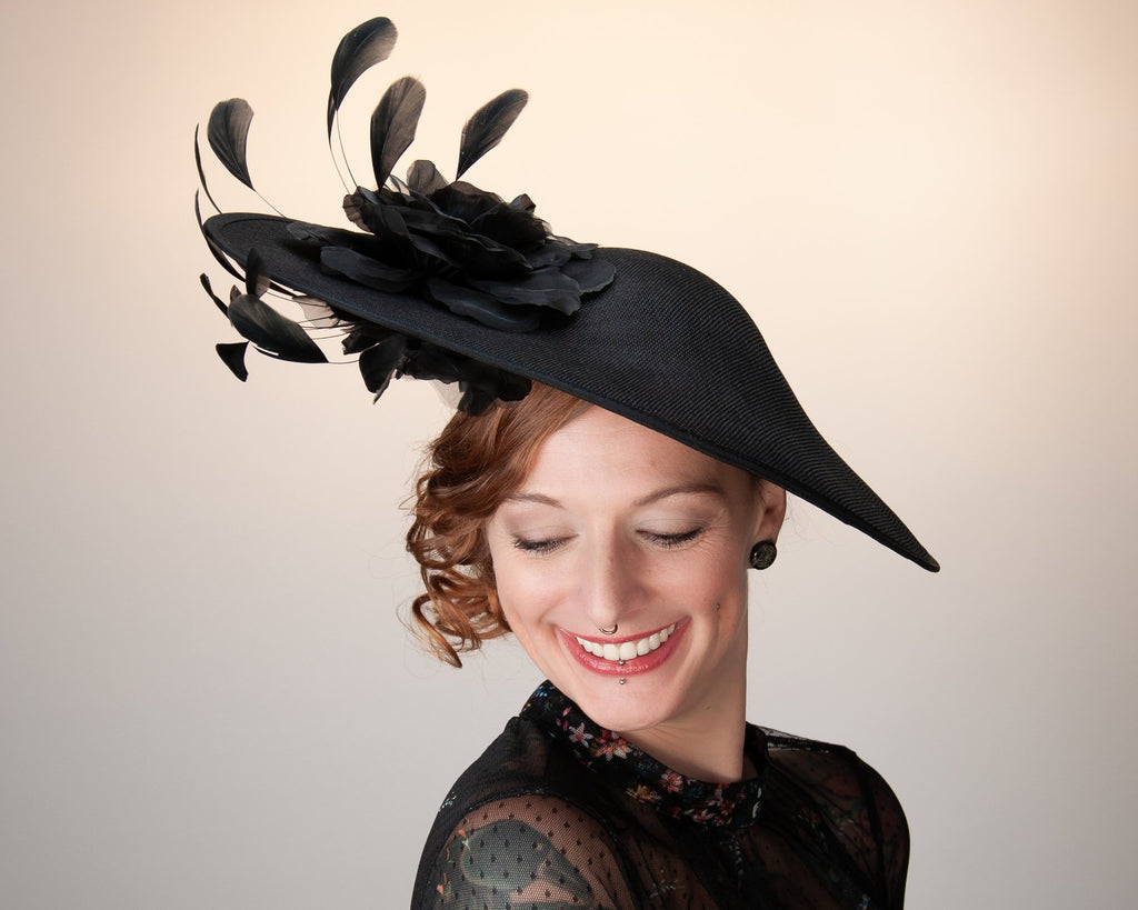 STATEMENT HAT - A BIG BASE WITH BLACK ROSES AND ROCKING FEATHERS © Seegang Berlin
