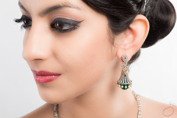 Flaired Bell Green Emerald Jhumkas studded with Diamonds and Gold
