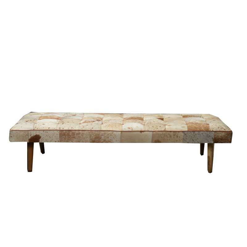 Daybed in cowhide with wooden legs - Deszine Talks